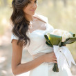 Beautiful bride outdoors in a forest — Stok fotoğraf