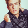 Portrait of good looking blonde man wearing a scarf — Stock Photo