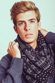 Portrait of good looking blonde man wearing a scarf — Stockfoto