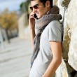 Stock Photo: Handsome man in urban background talking on phone