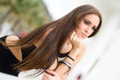 Young woman, wearing black dress, with long hair — Stock Photo