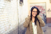 Young attractive girl in urban background — Stock Photo