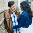 Cheerful young couple on a city street — Stock Photo #38690525