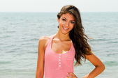 Beautiful woman with long pink dress on a tropical beach — Stock Photo
