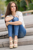 Young woman, wearing casual clothes, with long hair — Stock Photo