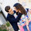 Cheerful young couple on a city street — Stock Photo #39719137