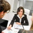 Business partners discussing documents and ideas at meeting — Stock Photo #39720541