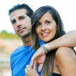 Happy young couple looking at something interesting - Copyspace — Stock Photo