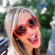 Funny girl with red heart glasses — Stock Photo #41711017