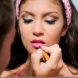 Professional make-up with a beautiful young woman by a beauticia — Stock Photo
