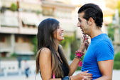 Couple in urban background enjoying themselves — Stock Photo
