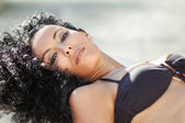 Young black woman, afro hairstyle, wearing bikini — Stock Photo