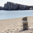 Pebbles in balancing on the beach — Stock Photo