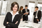 Business leader looking at camera in working environment  — Stock Photo