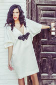 Woman, model of fashion, wearing white dress with curly hair — Stock Photo