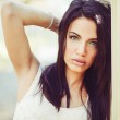 Young woman with green eyes in urban background — Stock Photo #47178949