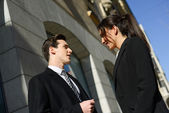 Business people talking outside of company building. Couple work — Stock Photo