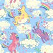 Cute seamless pattern with rainbow unicorns in the clouds — Vector de stock