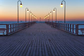 Pier at sunrise — Stock Photo
