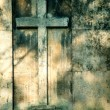 Foto Stock: Cross on wall background