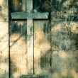Cross on wall background — Lizenzfreies Foto