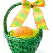 Painted easter eggs in basket, isolated on white background. — Stock Photo