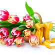 Bunch of red-yellow tulips in a basket on white background, — Stock Photo