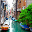 Narrow old street of Venice, Italy. - Stock Photo