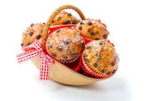 Muffins in a basket isolated on white background — Stock Photo