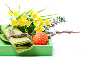 Easter egg with a serviette, in a tray for breakfast. isolated on white background. — Stock Photo