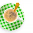 Green coffee cup with golden spoon, on white background — Stock Photo #19412191