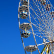 Attraction is the wheel of review on background blue sky — Stockfoto
