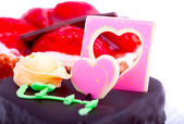 Chocolate cake with heart decoration — Stock Photo