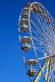 Attraction is the wheel of review on background blue sky — Stock Photo