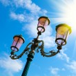 Old street-lamp on blue sky with sunlight in Venice — Stock Photo #19440851