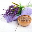 Stock Photo: Dry Lavender herbs, and flowers on serviette, on white wooden background