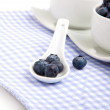 Fresh blueberry in white porcelain spoon, on serviette — Stock Photo