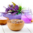 Dry Lavender herbs, bath salt and candle, on white wooden table — Stock Photo #19443681