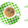Photo: Checked cup of coffee on white background