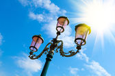 Old street-lamp on blue sky with sunlight in Venice — Stock Photo