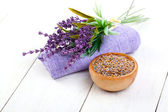 Dry Lavender herbs, and flowers on the serviette, on white wooden background — Stock Photo