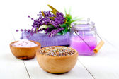 Dry Lavender herbs, bath salt and candle, on white wooden table — Fotografia Stock