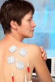 Electrodes of tens device on the woman — Stock Photo