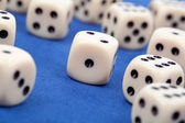 Gambling dices on blue background — Stok fotoğraf