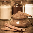 Постер, плакат: Cinnamon or chinese cinnamon in the transparent glass jar with