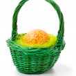 Royalty-Free Stock Photo: Painted easter eggs in basket, isolated on white background.