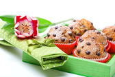 Muffins with a serviette, in a tray for breakfast. isolated on w — Stock Photo