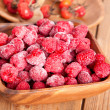 Frozen raspberries in the wooden bowl — Stock Photo #21253911