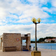 Berth with street-lamp on sea background. Pula Croatia - Stock Photo