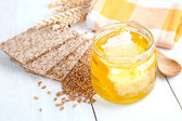 Honey with crispbread and wheat grain — Stock Photo